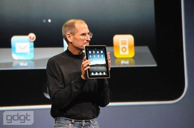 Steve Jobs holding the iPad