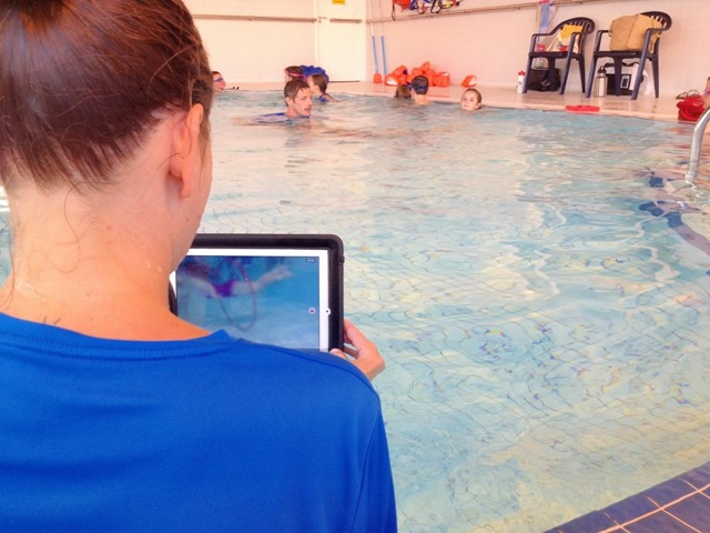 Ipad at work in and out of the pool running a swimming - Swimming pool management software ...