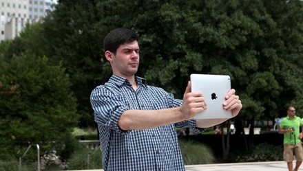 Man Taking Photo with iPad